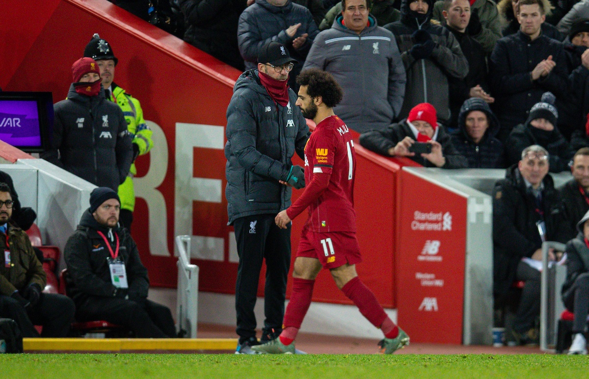 LIVERPOOL, ENGLAND - Saturday, November 30, 2019: Liverpool's Mohamed Salah shakes hands with manager Jürgen Klopp as he is substituted during the FA Premier League match between Liverpool FC and Brighton & Hove Albion FC at Anfield. (Pic by David Rawcliffe/Propaganda)