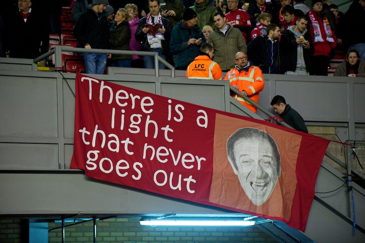 "LIVERPOOL, ENGLAND - Wednesday, February 2, 2011: Liverpool supporter's banner; ""There is a light that never goes out"" featuring a picture of Carry On actor Sid James during the Premiership match at Anfield. (Photo by David Rawcliffe/Propaganda)"