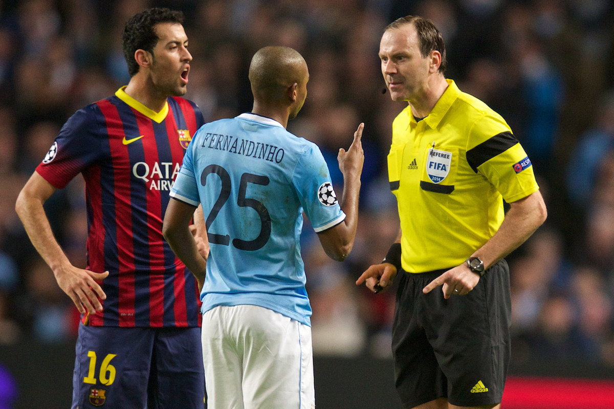 MANCHESTER, ENGLAND - Tuesday, February 18, 2014: Manchester City's Fernando Luiz Roza 'Fernandinho' is spoken to by referee Jonas Eriksson during the UEFA Champions League Round of 16 match against FC Barcelona at the City of Manchester Stadium. (Pic by David Rawcliffe/Propaganda)