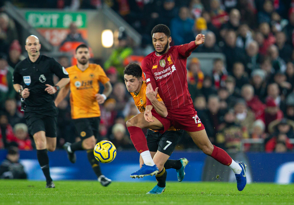LIVERPOOL, ENGLAND - Sunday, December 29, 2019: Liverpool's Joe Gomez (R) and Wolverhampton Wanderers' Pedro Neto during the FA Premier League match between Liverpool FC and Wolverhampton Wanderers FC at Anfield. (Pic by Richard Roberts/Propaganda)