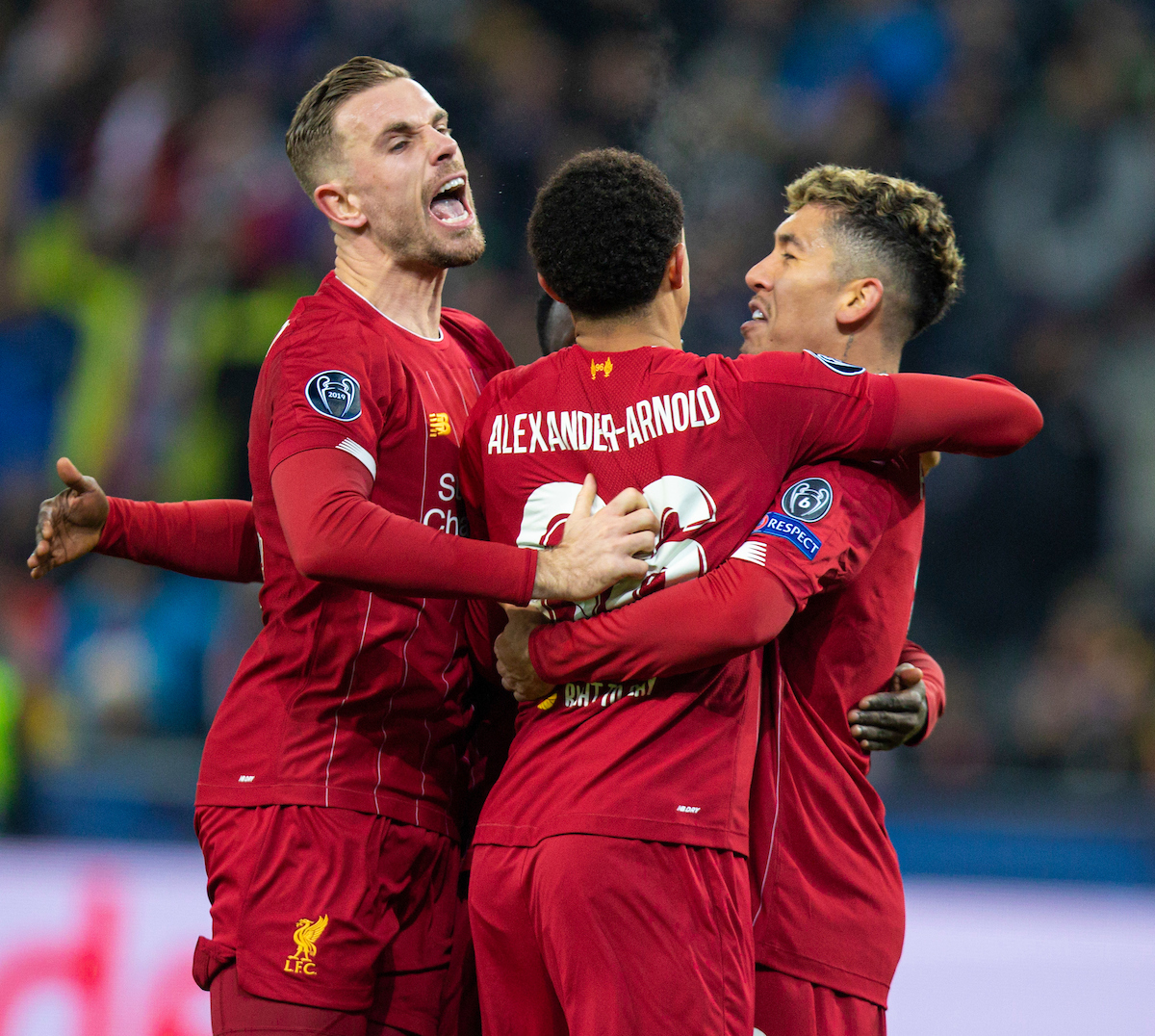 SALZBURG, AUSTRIA - Tuesday, December 10, 2019: Liverpool players captain Jordan Henderson, Trent Alexander-Arnold and Roberto Firmino celebrate the opening goal scored by Sadio Mané (hidden) during the final UEFA Champions League Group E match between FC Salzburg and Liverpool FC at the Red Bull Arena. (Pic by David Rawcliffe/Propaganda)