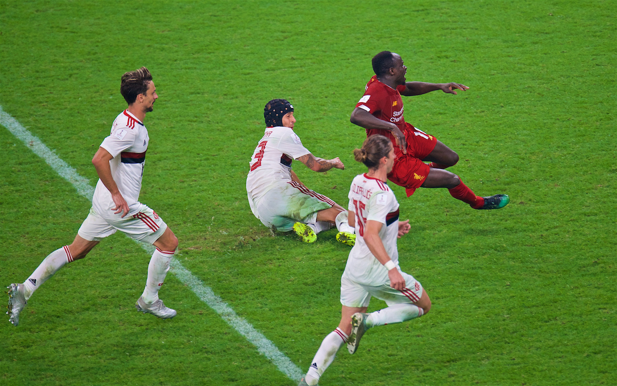 DOHA, QATAR - Saturday, December 21, 2019: Liverpool's Sadio Mané fouled by CR Flamengo's Rafael Alcântara do Nascimento 'Rafinha' but the penalty was disallowed after a VAR review during the FIFA Club World Cup Qatar 2019 Final match between CR Flamengo and Liverpool FC at the Khalifa Stadium. (Pic by Peter Powell/Propaganda)