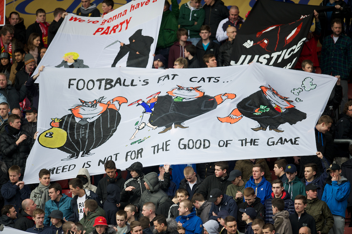 SOUTHAMPTON, ENGLAND - Saturday, March 16, 2013: Liverpool supporters protest at the high ticket prices with a banner 'Football's Fat Cats? Greed Is Not For The Good Of The Game' before the Premiership match against Southampton at St. Mary's Stadium. (Pic by David Rawcliffe/Propaganda)