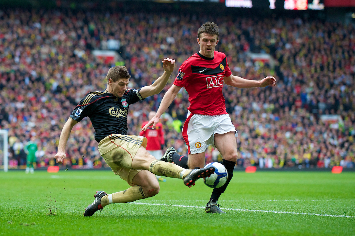 MANCHESTER, ENGLAND - Sunday, March 21, 2010: Liverpool's captain Steven Gerrard MBE and Manchester United's Michael Carrick during the Premiership match at Old Trafford. (Photo by: David Rawcliffe/Propaganda)
