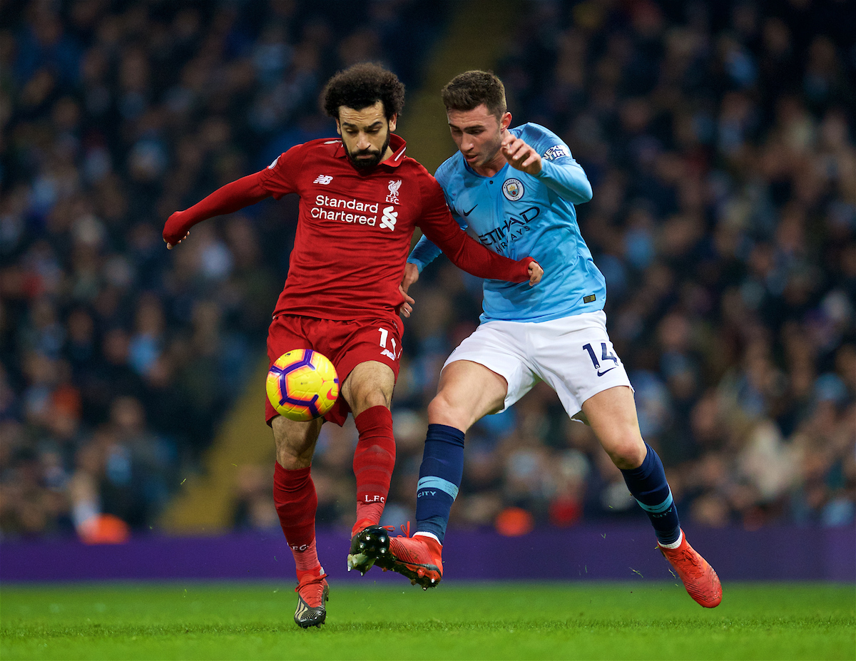 MANCHESTER, ENGLAND - Thursday, January 3, 2019: Liverpool's Mohamed Salah (L) and Manchester City's Aymeric Laporte (R) during the FA Premier League match between Manchester City FC and Liverpool FC at the Etihad Stadium. (Pic by David Rawcliffe/Propaganda)