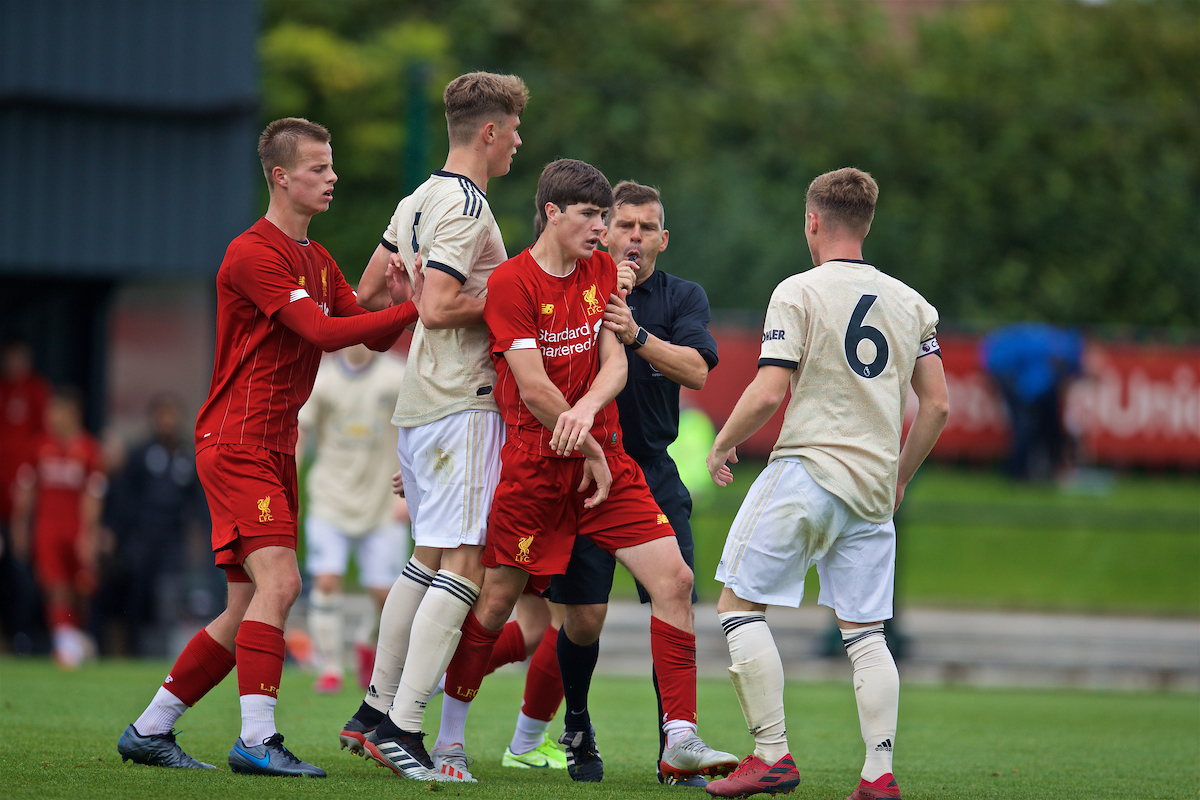 KIRKBY, ENGLAND - Saturday, August 31, 2019: Liverpool's Layton Stewart clashes with Manchester United's captain Charlie McCann after the Under-18 FA Premier League match between Liverpool FC and Manchester United at the Liverpool Academy. Liverpool won 4-3. (Pic by David Rawcliffe/Propaganda)