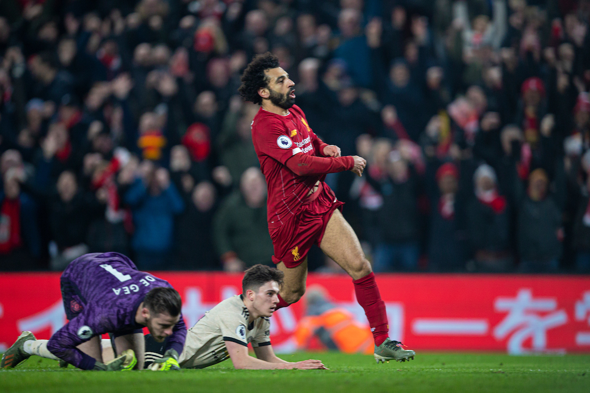 LIVERPOOL, ENGLAND - Sunday, January 19, 2020: Liverpool's Mohamed Salah takes off his shirt as he celebrate scoring the second goal during the FA Premier League match between Liverpool FC and Manchester United FC at Anfield. Liverpool won 2-0. (Pic by David Rawcliffe/Propaganda)