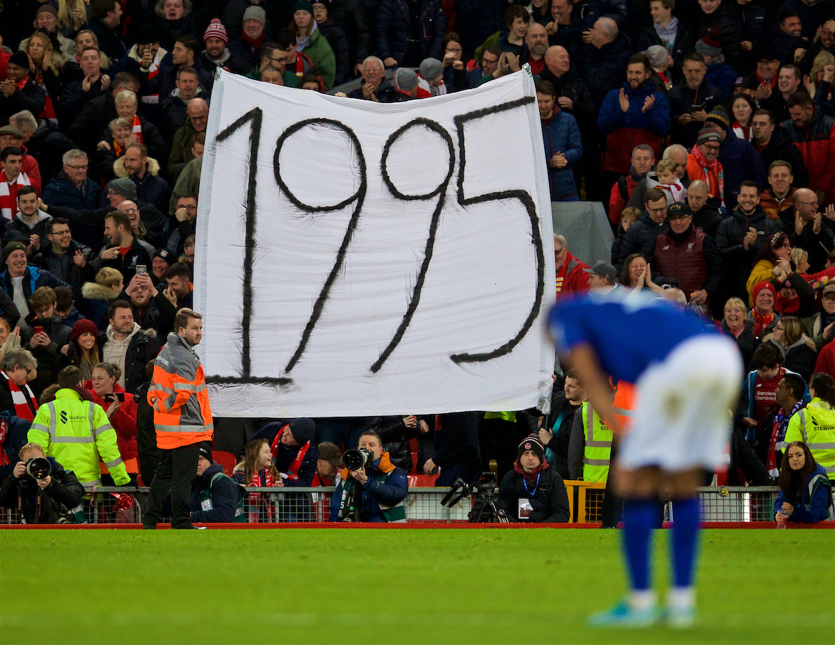 """LIVERPOOL, ENGLAND - Sunday, January 5, 2020: Liverpool supporters hold up a banner """"1995"""" - the last time Everton won a trophy - after knocking them out of the FA Cup with a 1-0 victory during the FA Cup 3rd Round match between Liverpool FC and Everton FC, the 235th Merseyside Derby, at Anfield. (Pic by David Rawcliffe/Propaganda)"""