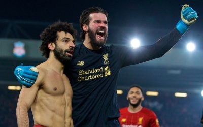 Liverpool's Mohamed Salah celebrates scoring the second goal with team-mate goalkeeper Alisson Becker during the FA Premier League match between Liverpool FC and Manchester United FC at Anfield