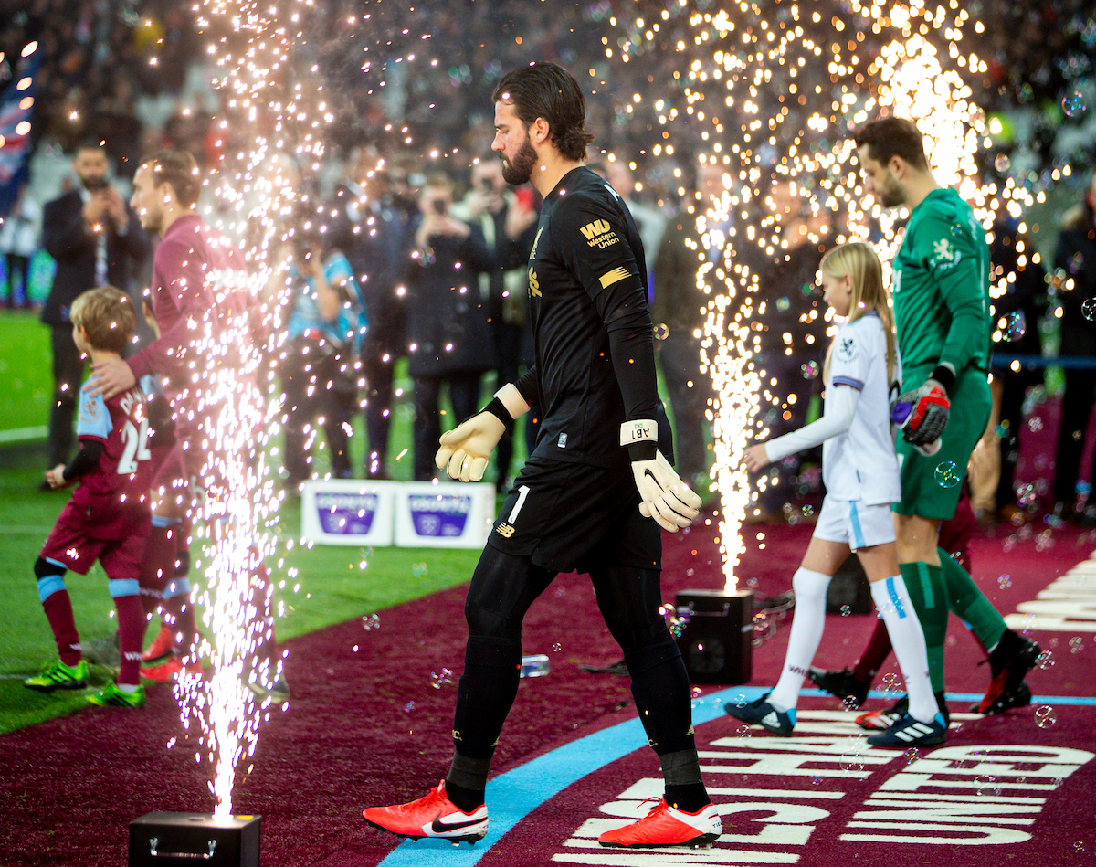 LONDON, ENGLAND - Wednesday, January 29, 2020: Liverpool's goalkeeper Alisson Becker walks out through pyrotechnics before the FA Premier League match between West Ham United FC and Liverpool FC at the London Stadium. (Pic by David Rawcliffe/Propaganda)