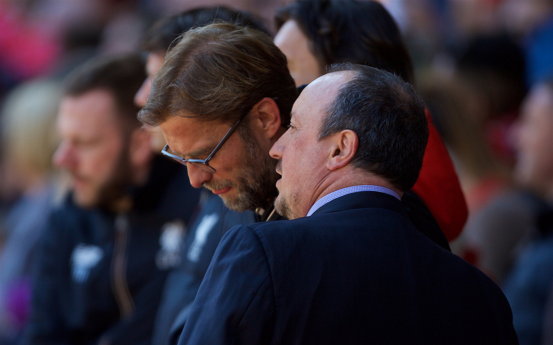 Jurgen Klopp shares a joke with Newcastle United's manager Rafael Benitez during the Premier League match at Anfield.
