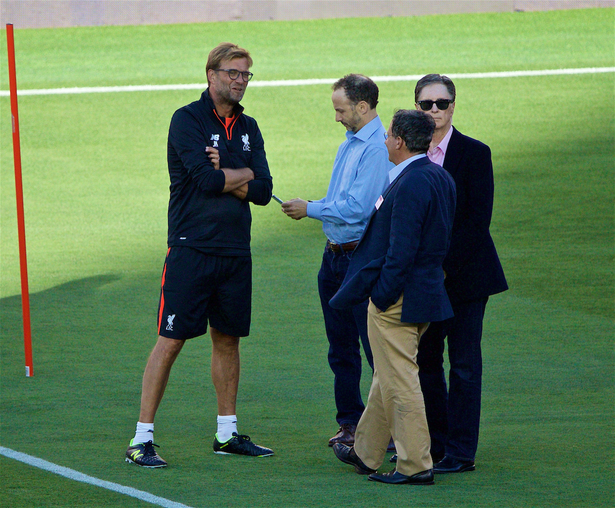 Liverpool's manager Jürgen Klopp chats with co-owner and FSG Chairman Tom Werner, owner John W. Henry and Director Michael Gordon during a training session