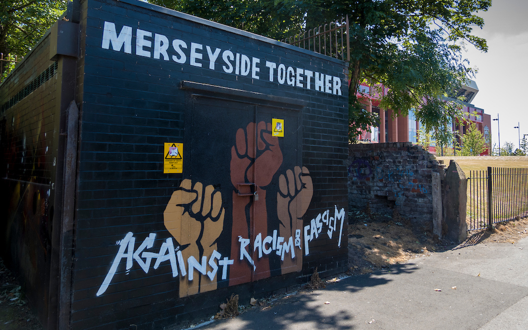 """""""Merseyside Together Against Racism and Fascism"""" Graffiti painted on a wall in Stanley Park, Anfield, between Liverpool FC's and Everton FC's stadiums"""