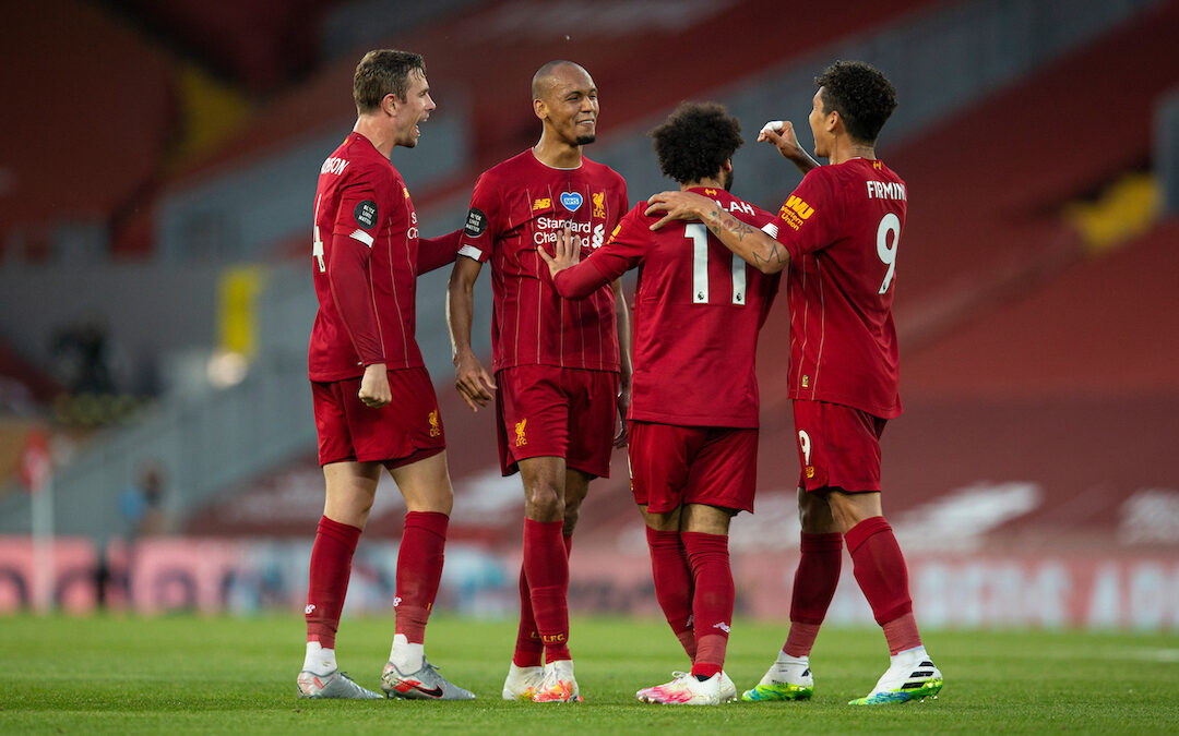 Liverpool's Fabio Henrique Tavares 'Fabinho' (2nd from L) celebrates scoring the third goal with team-mates captain Jordan Henderson (L), Mohamed Salah (2nd from R) and Roberto Firmino during the FA Premier League match between Liverpool FC and Crystal Palace FC at Anfield.