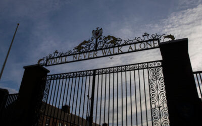 A silhouette of the Shankly Gates at Anfield