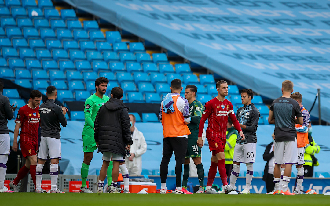 Newly crowned Champions Liverpool walk out through a guard of honour from Manchester City players