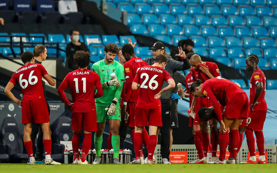 Liverpool's manager Jürgen Klopp speaks to his players during a water break during the FA Premier League match between Manchester City FC and Liverpool FC at the Eithad Stadium