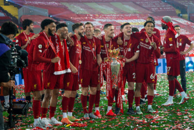 Liverpool's Andy Robertson celebrates with the Premier League trophy as The Reds are crowned Champions