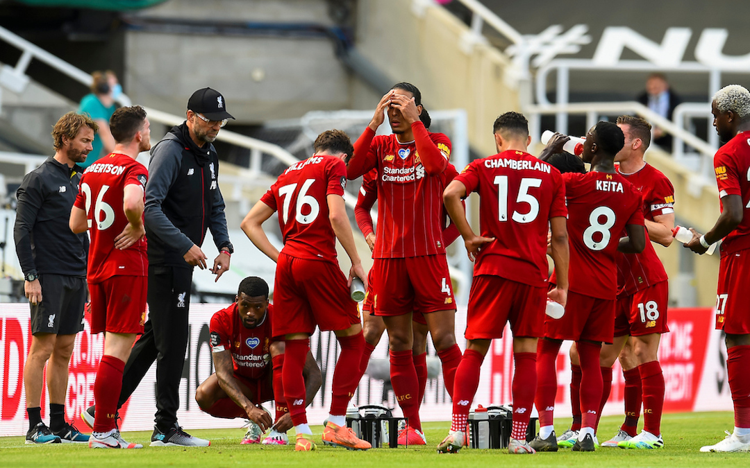 Liverpool's manager Jürgen Klopp speaks to his players during a water break during the final match of the FA Premier League season between Newcastle United FC and Liverpool FC at St. James' Park