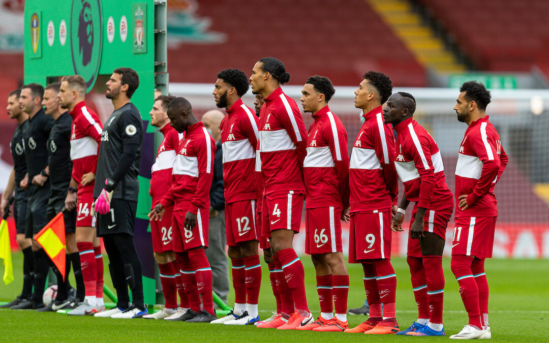 Liverpool FC players line up at Anfield