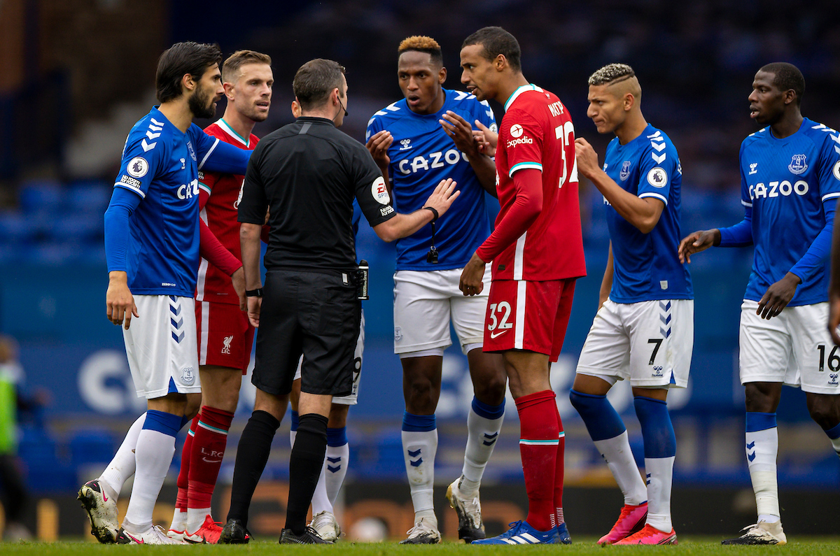 Everton's André Gomes, Yerry Mina, Richarlison de Andrade and Liverpool's captain Jordan Henderson and Joel Matip argue with referee Michael Oliver during the FA Premier League match between Everton FC and Liverpool FC, the 237th Merseyside Derby, at Goodison Park