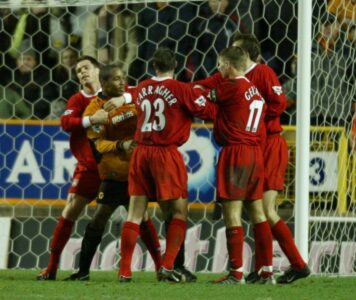 Wolverhampton Wanderers' Paul Ince clashes with Liverpool's Steven Gerrard