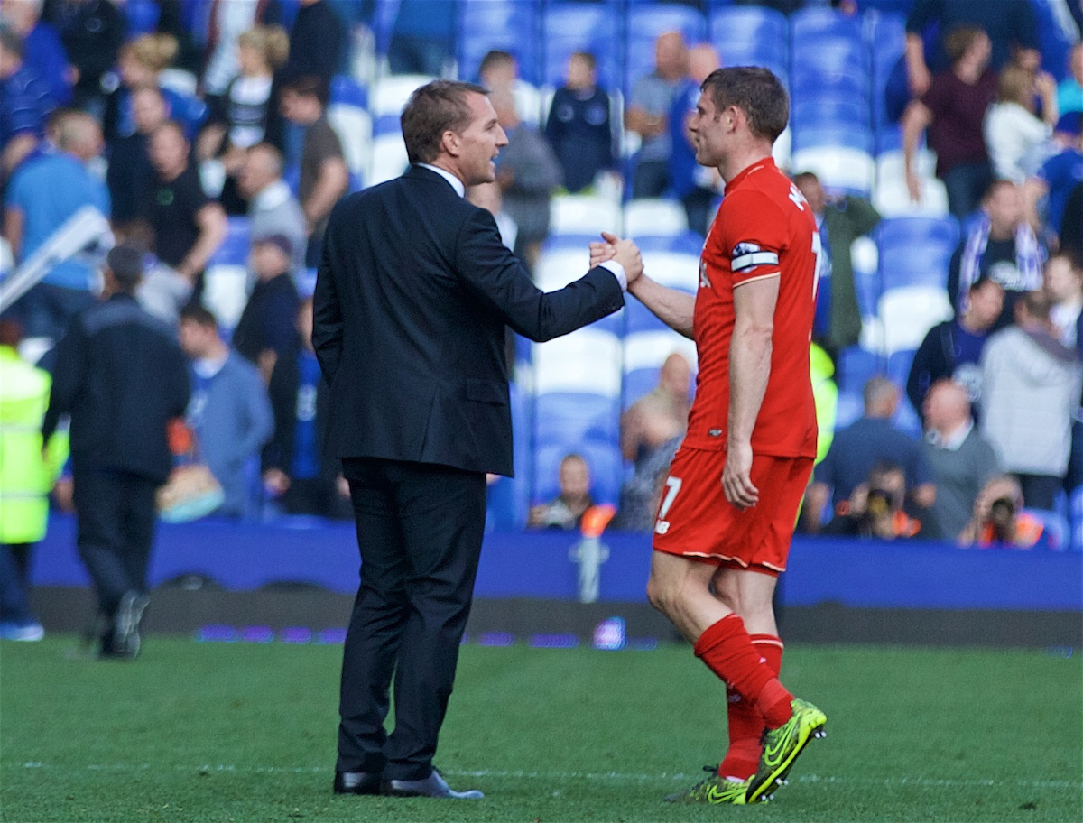 Former Liverpool manager Brendan Rodgers shakes hands with James Milner