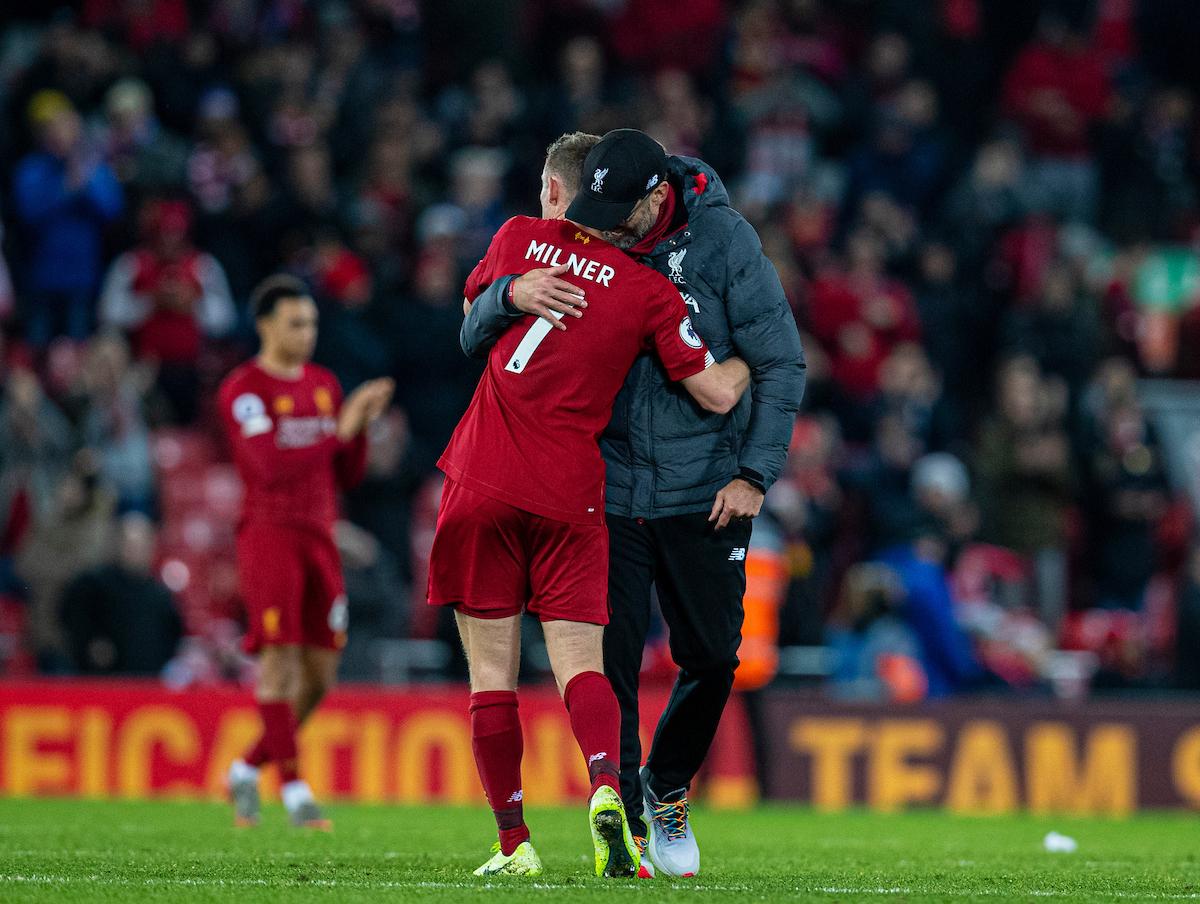 Liverpool's manager Jürgen Klopp embraces James Milner