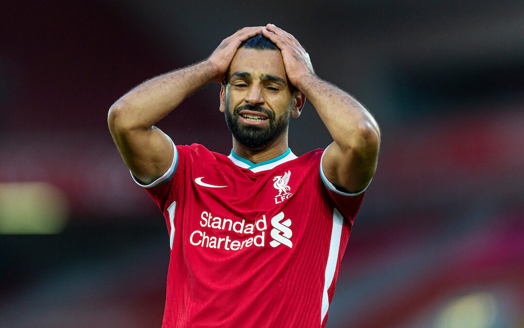 Liverpool's Mohamed Salah looks dejected