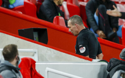 Referee Kevin Friend reviews an incident on the VAR