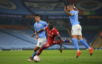 Liverpool's Sadio Mané is fouled by Manchester City's Kyle Walker for a penalty during the FA Premier League match between Manchester City FC and Liverpool FC at the Etihad Stadium