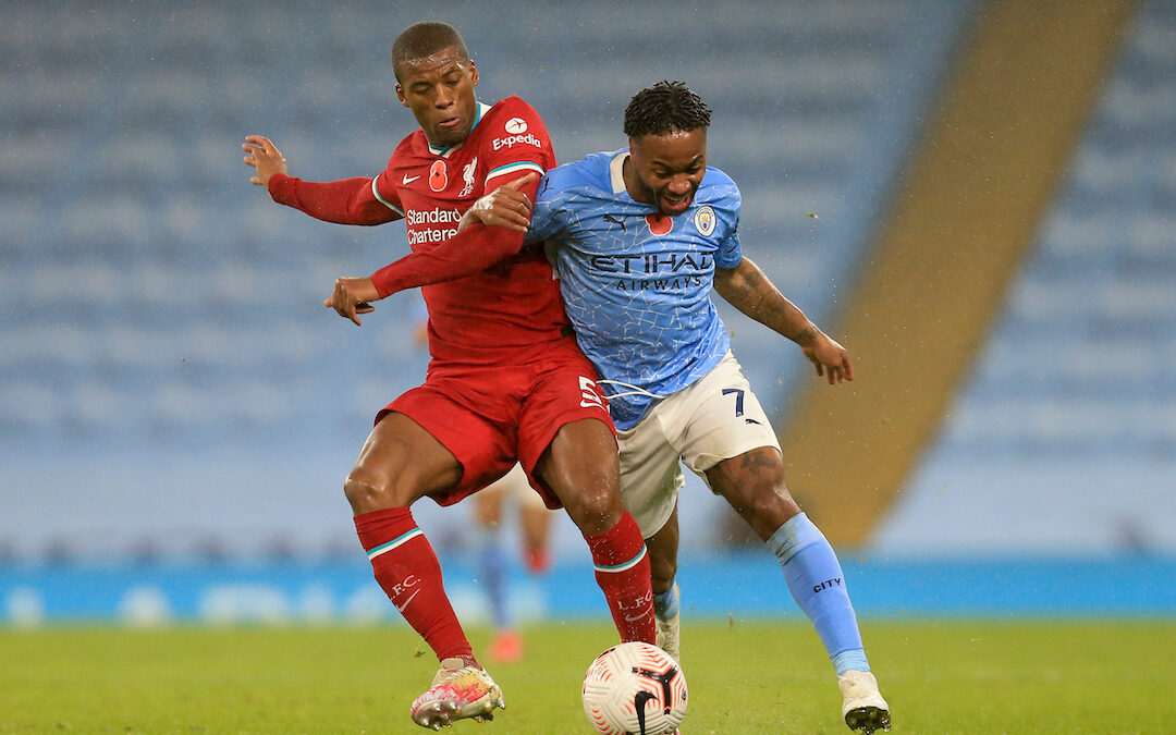 Liverpool's Georginio Wijnaldum (L) challenges Manchester City's Raheem Sterling during the FA Premier League match between Manchester City FC and Liverpool FC at the Etihad Stadium