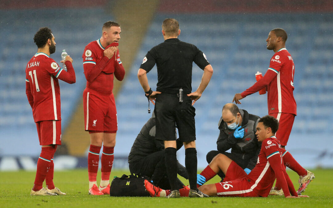 Liverpool's Trent Alexander-Arnold receives treatment for an injury that forced him out of the game during the FA Premier League match between Manchester City FC and Liverpool FC at the Etihad Stadium