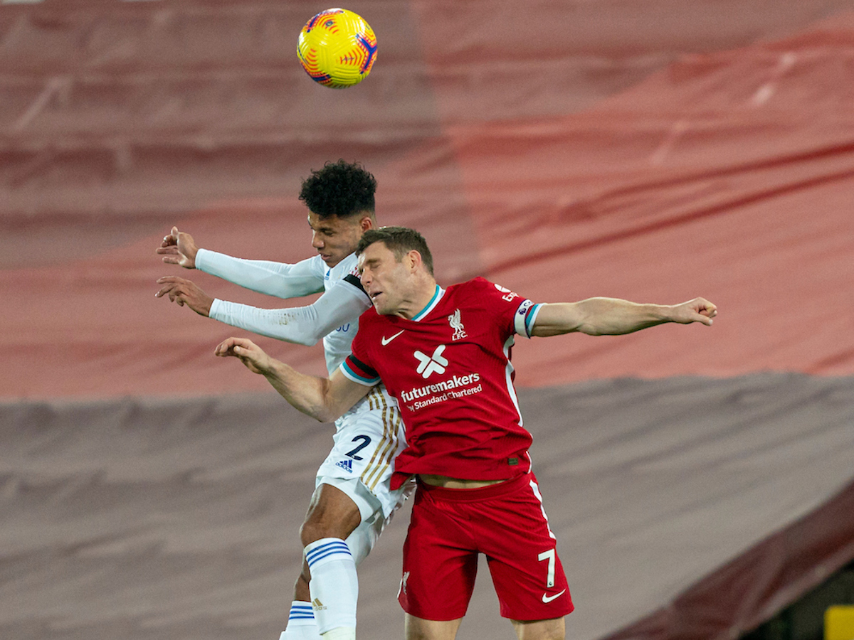 Liverpool's James Milner challenges for a header during the FA Premier League match between Liverpool FC and Leicester City FC at Anfield