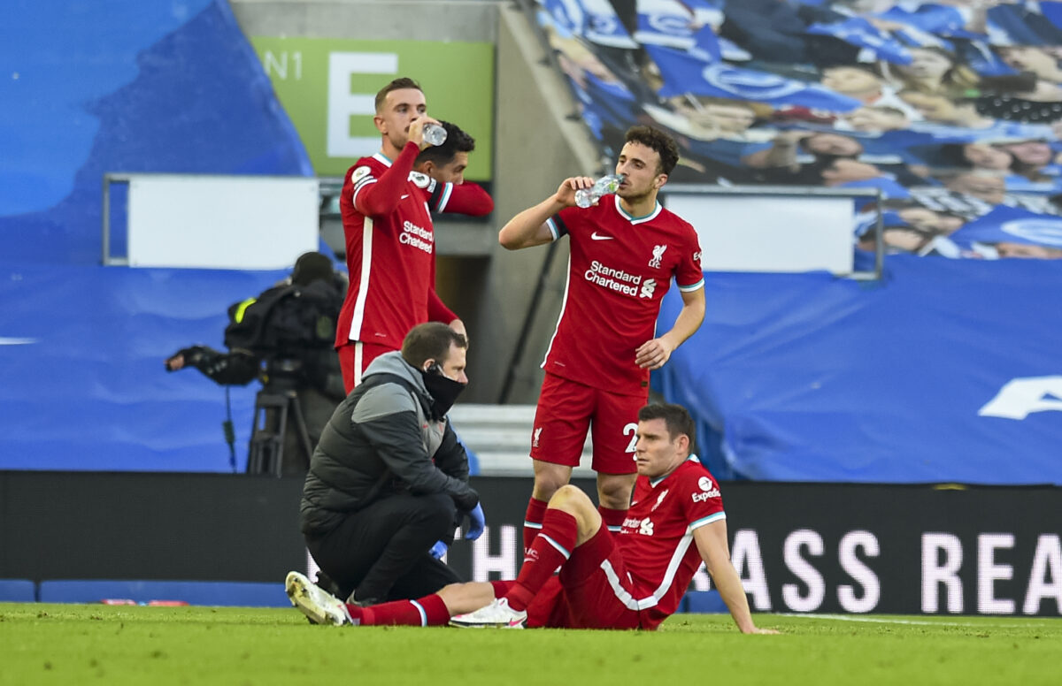 Liverpool's James Milner is treated for an injury during the FA Premier League match between Brighton & Hove Albion FC and Liverpool FC at the AMEX Stadium