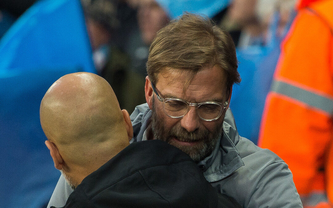 Jurgen Klopp manager of Liverpool and Pep Guardiola manager of Manchester City react before the match at the Etihad Stadium