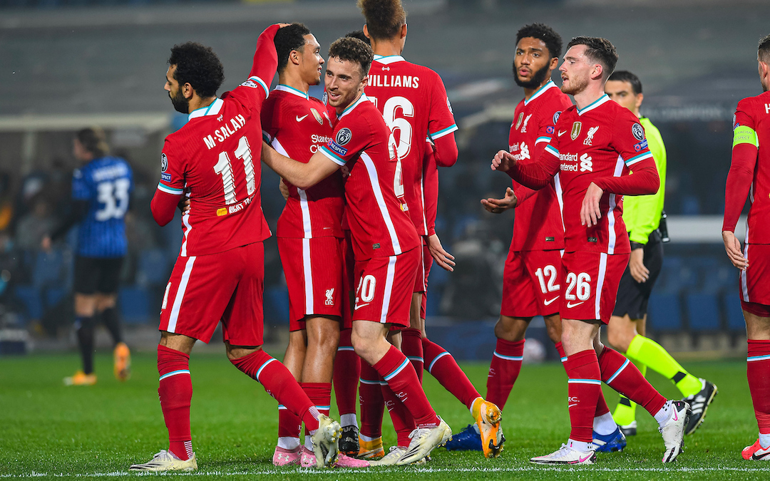 Liverpool's Diogo Jota (C) celebrates after scoring the first goal with team-mates during the UEFA Champions League Group D match between Atalanta BC and Liverpool FC at the Stadio di Bergamo