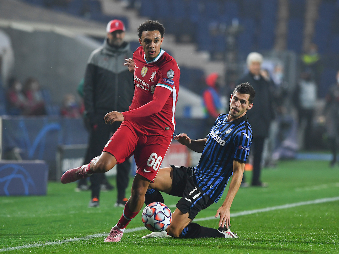 Liverpool's Trent Alexander-Arnold (L) gets past Atalanta's Remo Freuler during the UEFA Champions League Group D match between Atalanta BC and Liverpool FC at the Stadio di Bergamo.