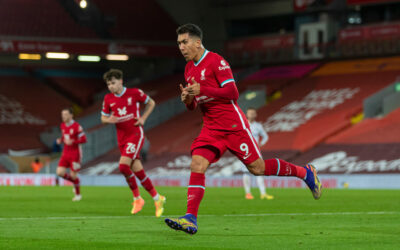 Liverpool's Roberto Firmino celebrates after scoring the third goal during the FA Premier League match between Liverpool FC and Leicester City FC at Anfield