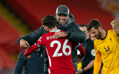 Liverpool's manager Jürgen Klopp embraces Andy Robertson after the FA Premier League match between Liverpool FC and Leicester City FC at Anfield