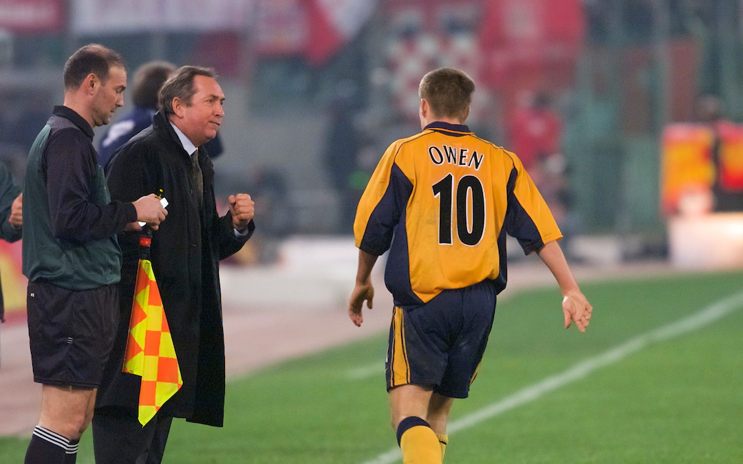 Liverpool's Michael Owen celebrates his goal against AS Roma with manager Gerard Houllier
