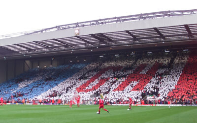 Liverpool's supporters on the Spion Kop pay tribute to manager Gerard Houllier