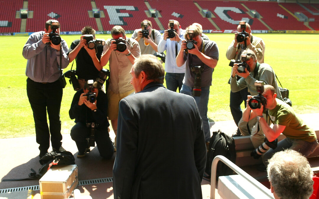Liverpool's manager Gerard Houllier walks out to face the press