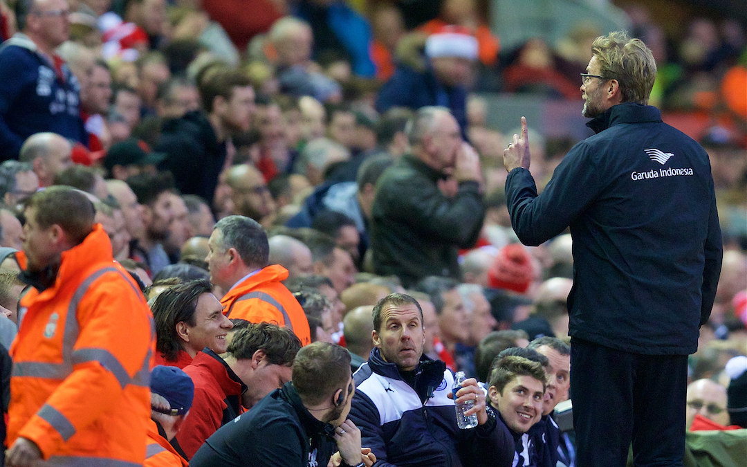 Liverpool's manager Jürgen Klopp shares a joke with a supporter at Anfield
