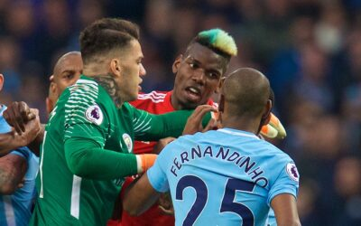 Manchester United's Paul Pogba clashes with Manchester City's Fernandinho