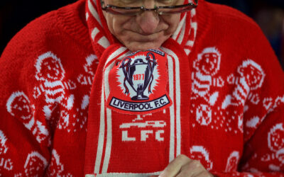 A Liverpool supporter wearing a Christmas jumper