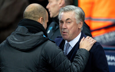 Everton's manager Carlo Ancelotti (R) and Manchester City's manager Pep Guardiola