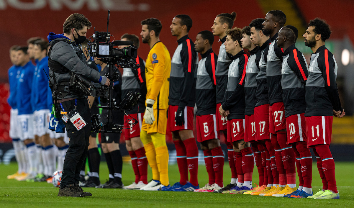 Liverpool players line up before a UEFA Champions League match at Anfield