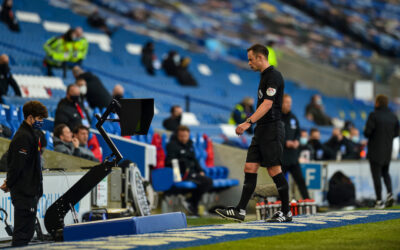 Referee Stuart Atwell looks at the VAR monitor during the FA Premier League match between Brighton & Hove Albion FC and Liverpool FC at the AMEX Stadium