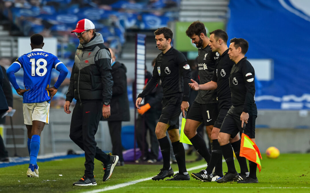 Liverpool's Jürgen Klopp and Alisson Becker speak with referee Stuart Atwell after the FA Premier League match with Brighton & Hove Albion FC